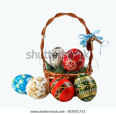 Basket with hand painted Easter eggs on a white background. Easter theme. happy Easter