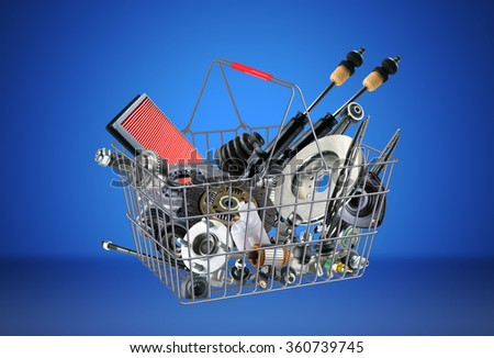 Basket with many auto parts for the passenger car. Auto parts for shop, aftermarket, OEM. Auto parts like in shop. New auto parts from OEM. Many auto parts for car. New auto parts in basket. - stock photo