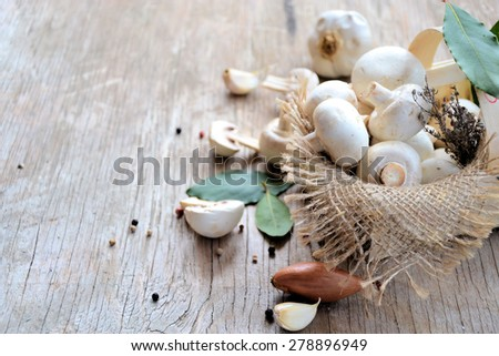 Basket with mushrooms on a wooden background, organic food - stock photo