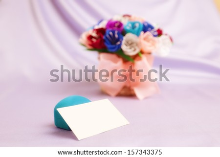 Basket with paper flowers, velvet box and blank card - stock photo