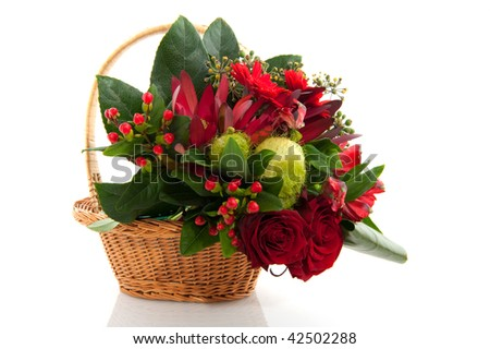 Basket with red bouquet of christmas flowers