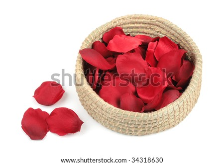 Basket with red roses petals - stock photo