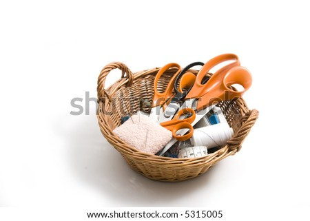 Basket with scissors, pins and threads - stock photo