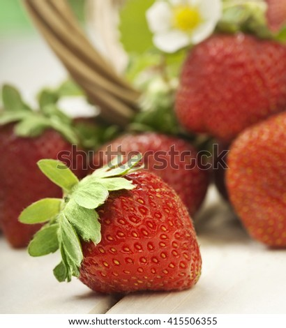 basket with strawberry on white table