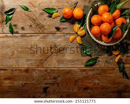 Basket with tasty tangerines on a wooden table  - stock photo
