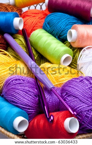 basket with thread and balls for knitting as a background - stock photo