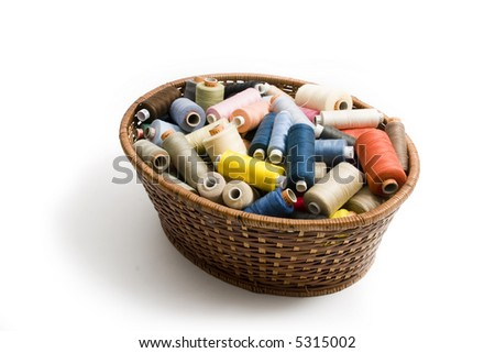 Basket with threads - stock photo
