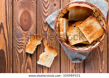basket with toast on a napkin near halves of toast