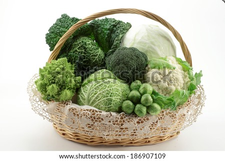 Basket with various cabbages - Savoy cabbage, romanesco, cauliflower, white head cabbage, broccoli, brussels sprouts, Chinese cabbage - isolated on white background - stock photo