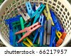 basket with various clothespins - stock photo