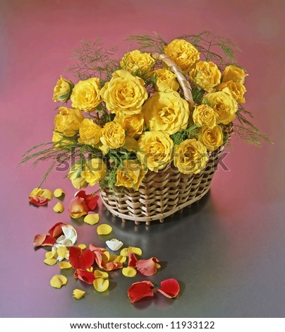 basket with yellow roses - stock photo