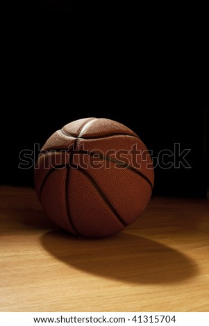 Basketball against the dark - stock photo