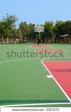 Basketball backboard and hoop at end of court - stock photo