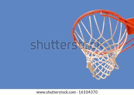 Basketball backboard hoop and net against a blue sky - stock photo