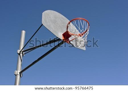 Basketball backboard on a clear summer day. - stock photo