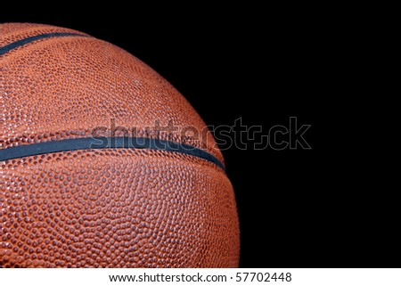Basketball ball isolated on black - stock photo