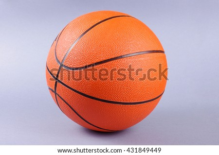 Basketball ball isolated on the gray background - stock photo
