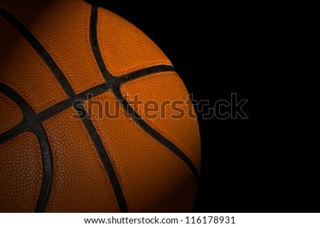 Basketball ball on dark background - stock photo