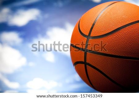 Basketball ball over blue sky background  - stock photo