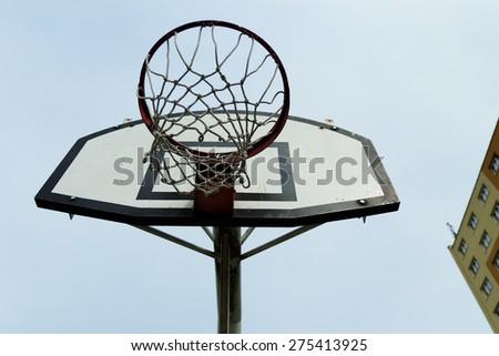 basketball basket, closeup against the sky - stock photo