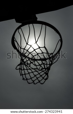 basketball basket, closeup against the sky; black and white - stock photo