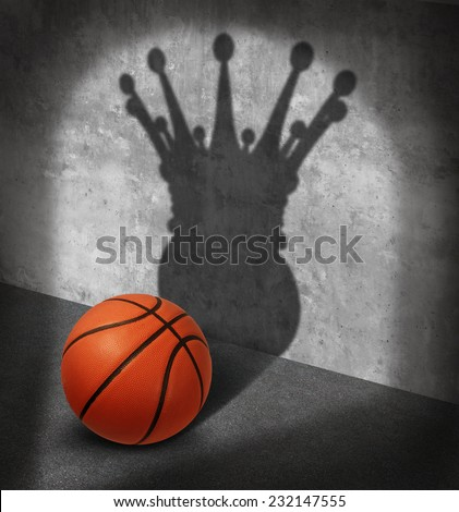 Basketball champion and championship concept as a ball casting a shadow wearing a king crown as a  visualizing victory metaphor on the court shooting hoops as a symbol for sports psychology success. - stock photo
