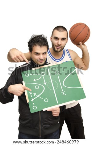 Basketball coach and player pointing at blackboard, winning tactics, isolated on white, selective focus on coach - stock photo