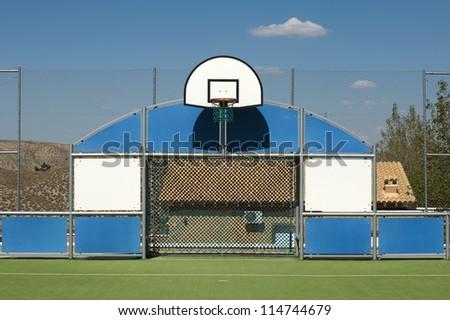 Basketball court and basketball basket - stock photo