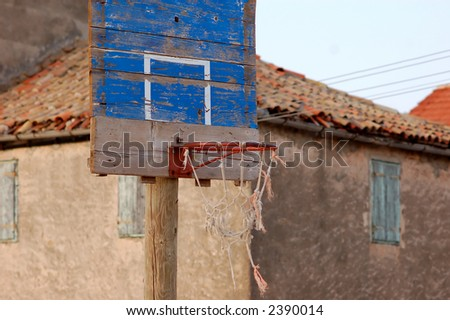 Basketball court in rural place on small Croatian island - stock photo