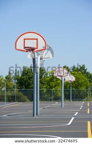 Basketball court on the black top - stock photo
