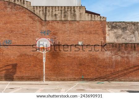 Basketball court with old ring outdoor in Sant Feliu de Llobregat, Barcelona, Spain - stock photo