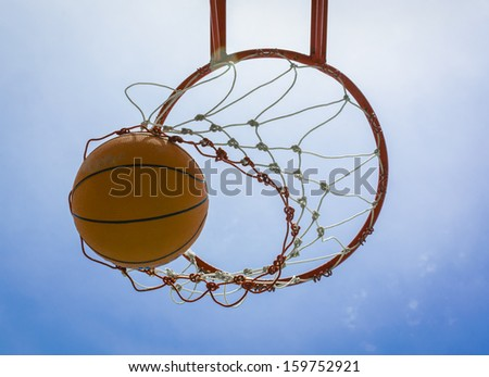 basketball field goal with the sky in background - stock photo
