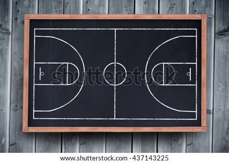 Basketball field plan against blackboard with copy space on wooden board