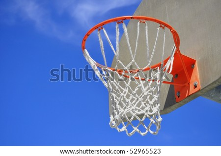 Basketball Hoop against a pretty blue sky, room for your text - stock photo