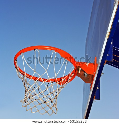 Basketball hoop against a sky.