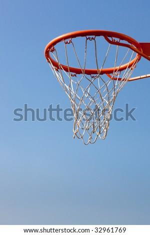 Basketball hoop against blue skies. Concept shot of aim, destination, goal, target - stock photo