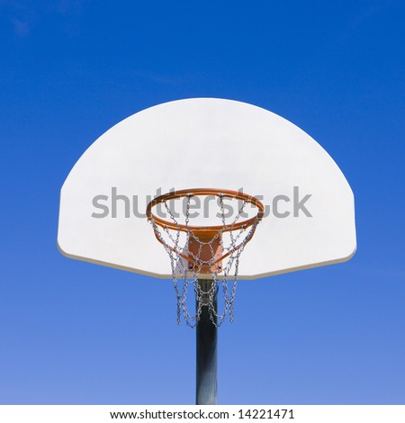 Basketball hoop against blue sky - stock photo