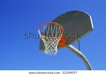 Basketball hoop blue sky room for copy space - stock photo