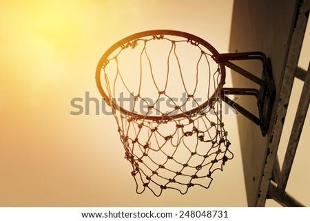 Basketball hoop in vintage filter. - stock photo