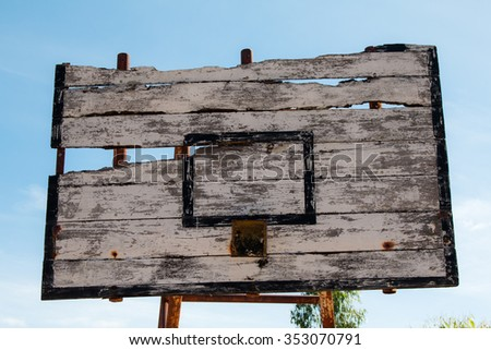 Basketball hoop is broken and wood board damaged ,Shiny wooden basketball - stock photo
