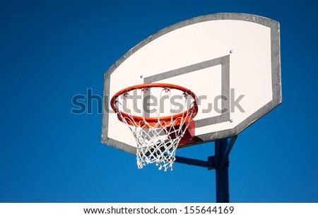 Basketball hoop on a blue sky. - stock photo