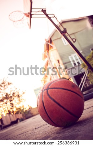 Basketball hoop on street in front of  home on autumn day - stock photo