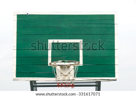 Basketball Hoop  - Outdoor basketball hoop and green backboard, taken from a front view. Isolated on sky background. - stock photo