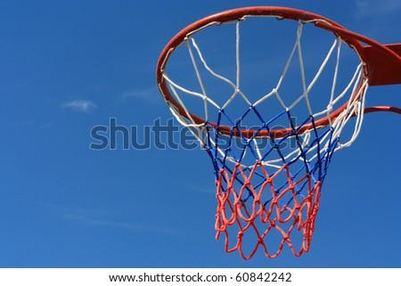 Basketball hoop over blue sky - stock photo