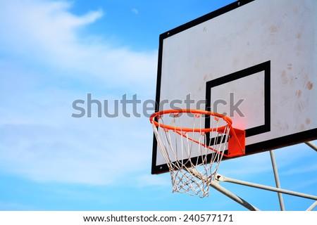 basketball hoop under a blue sky - stock photo