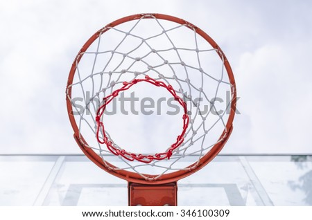 basketball hoop viewed from below,focus on red zone - stock photo