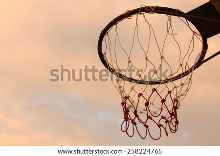 Basketball hoop with cloudy sky - stock photo