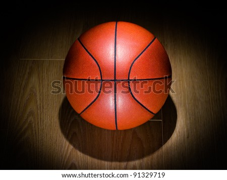 BasketBall in a spotlight after the game - stock photo