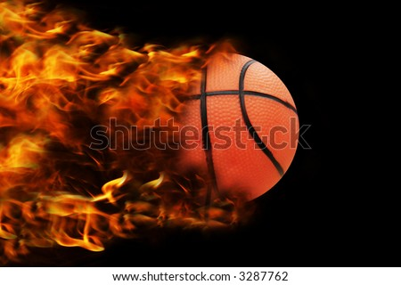 basketball in full speed, fire behind - stock photo