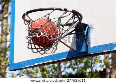Basketball in hoop close up - stock photo
